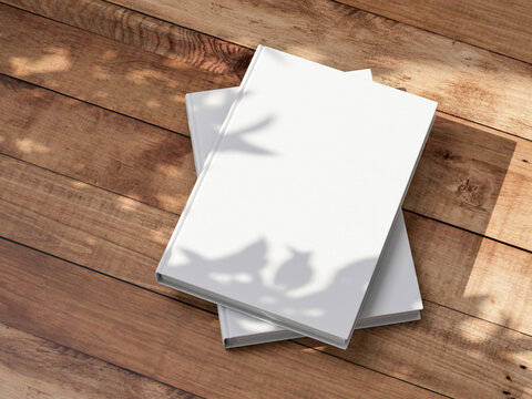 Two White Books Mockup with textured hardcover on wooden table outdoors