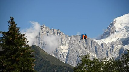 Wall Mural - Paragliding Extreme Sport Theme. Paraglider and the Scenic Summer Mountains Landscape