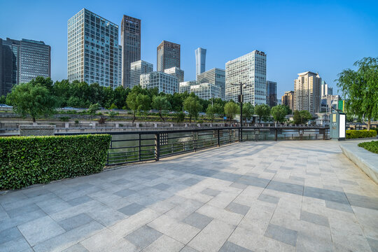 Panoramic skyline and buildings with empty square floor.