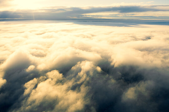 Aerial view white clouds in blue sky. View from drone. Aerial view cloudscape texture background. Texture of clouds. View from above. Panorama clouds background