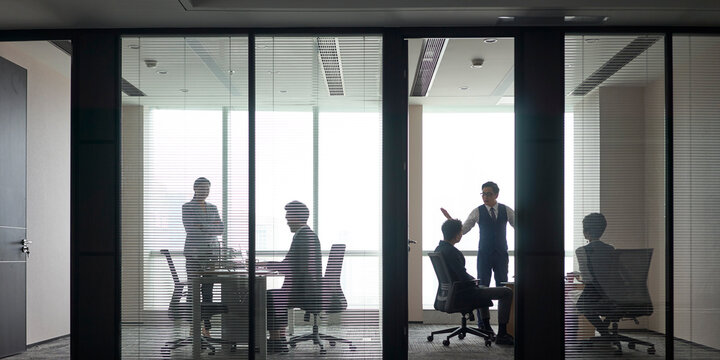 panorama view of business people working in modern office