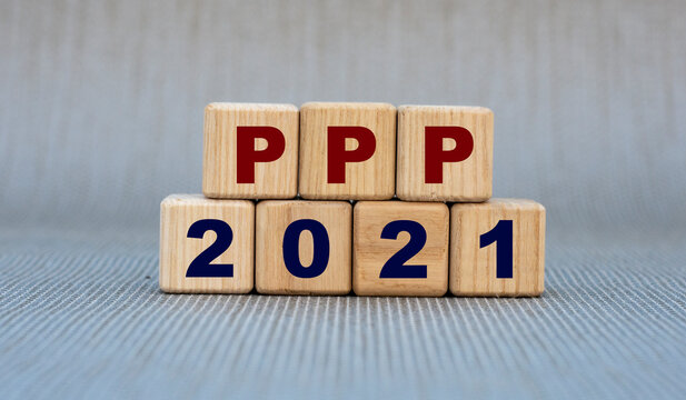 PPP 2021 - word on wooden cubes on a gray background