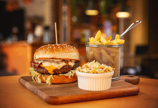 Tasty burger with fries