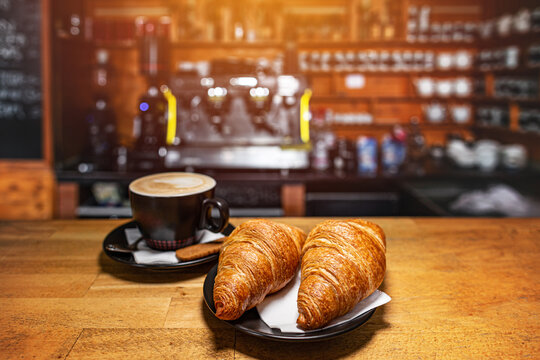 Freshly baked croissants and cup of coffee