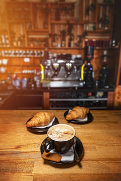 Coffee drink served with croissant