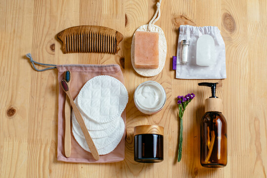 Eco-friendly bathroom accessories, reusable sponges for washing, tooth powder, toothbrushes, washcloths, loofah, pumice, massage brushes, hair comb. Top view. Zero waste set.