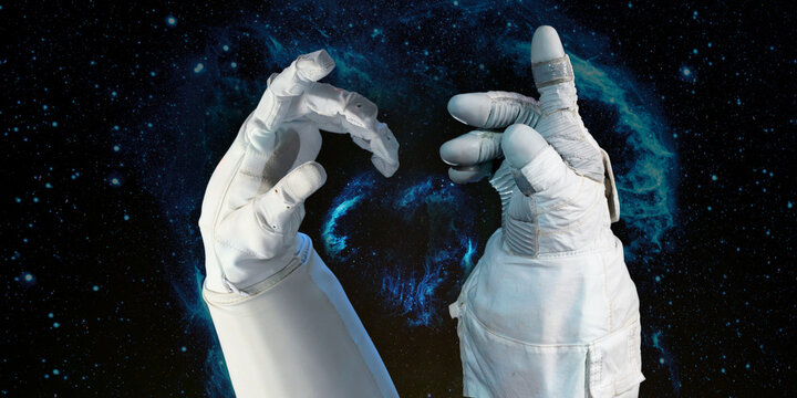 Bright stars in a night sky arranged in the shape of a heart, heart galaxy  in astronaut hands. Love shape astronaut hands. Elements of this image furnished by NASA.