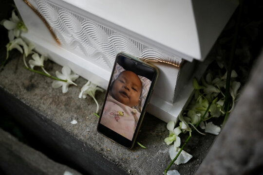Burial of three-month old baby separated from jailed mother