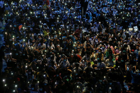 People light flashlights from their phones during anti-government protests, in Bangkok