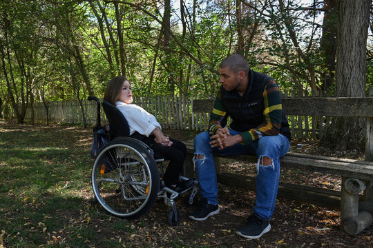 Eleftheria Tosiou and Marios Giannakou chat in a park during an interview with Reuters in Drama