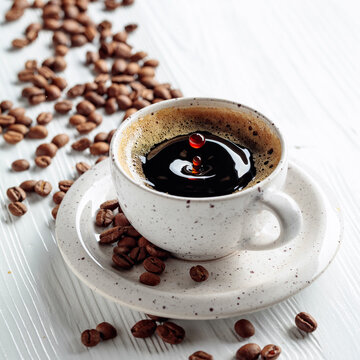 Black coffee and coffee beans on a white wooden table.