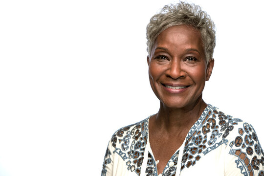 Portrait of older black woman looking at camera with smile