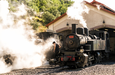 old steam train locomotive in the countryside
