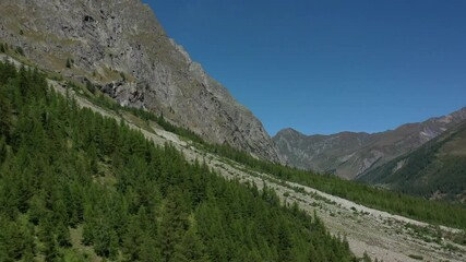 Wall Mural - Aerial Footage of Mountain Alpine Landscape During Sunny Sumer Day. Northern Italy Val Ferret Region.
