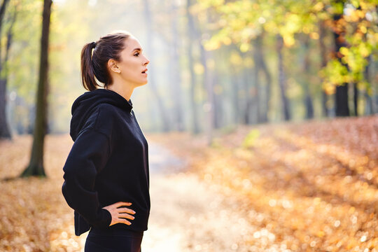 Young woman during break in autumn forest