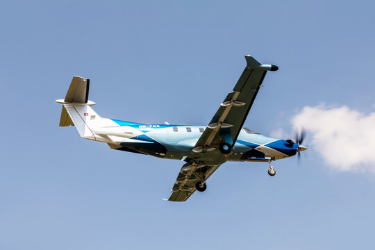 PRIBRAM, CZECH REPUBLIC - 12 August 2020. Pilatus PC-12 NGX, Single-engine turboprop blue airplane. The plane leaves from a small airport.