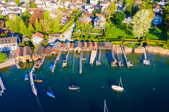 Germany, Bavaria, Tutzing, Sailboats in front of boathouses on shore of Lake Starnberg
