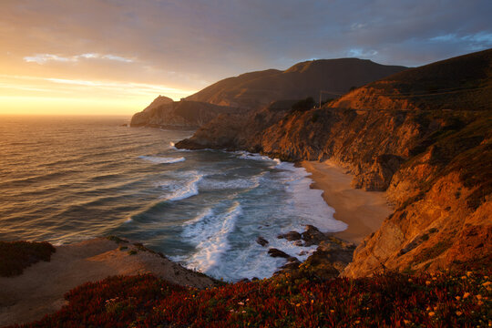 Scenic view of rocky coastline during sunset