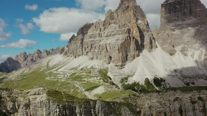 Wall Mural - Summit of Tre Cime di Lavaredo in the Italian Alps. Aerial Dolomites Footage.