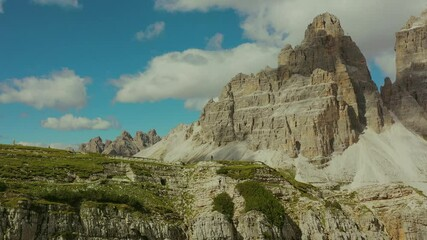 Wall Mural - Northern Italy. Tourists on the Dolomites Trail with Tre Cime di Lavaredo in the Background Aerial Vista