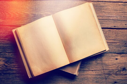 Vintage open book on old wooden table