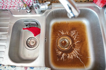 clogged kitchen sink at home
