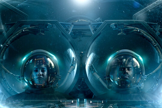 Two astronauts in futuristic space suits