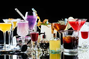 alcoholic cocktails on a mirror background