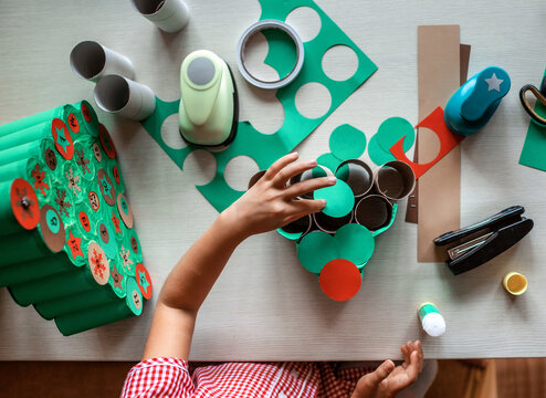 Kids making handmade advent calendar with toilet paper rolls at home. Seasonal activity for kids