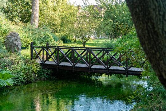 old wooden bridge in the Garden of Ninfa in Italy