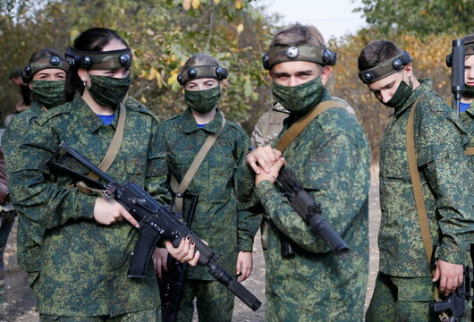 Members of a youth military patriotic club take part in a tactical shooting game in Makeyevka