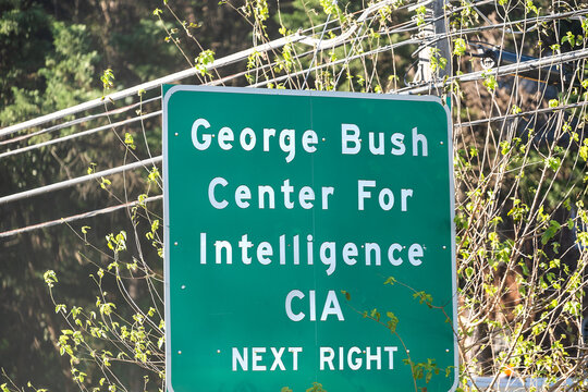 Langley, USA - October 12, 2018: Road sign for CIA Headquarters complex in Virginia, green closeup text for George Bush Center Central Intelligence Agency headquarters