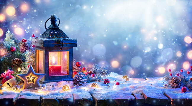 Christmas Lantern With Fir Branch and Decoration On Snowy Table