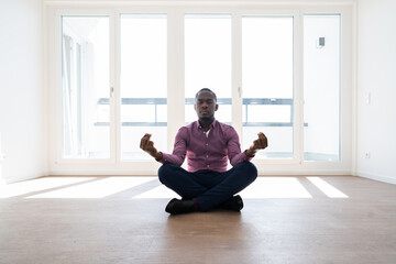 African American Man Meditating And Relaxing