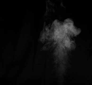 Figured smoke on a dark background. Abstract background, design element, for overlay on pictures