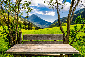 wooden picnic table at the alps