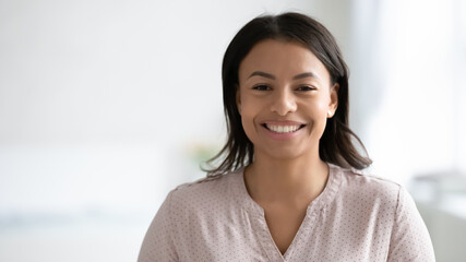 Photo sur Plexiglas Dinosaurs Narrow wide panoramic view headshot portrait of smiling African American young woman pose at home. Banner profile picture of happy biracial female renter or tenant look at camera. Copy space.