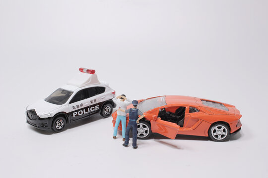 a Traffic accident,  Scale police car model with figure