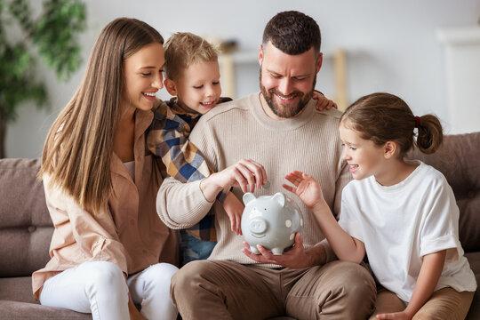 Happy family saving money together.