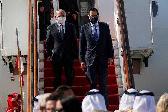 Israeli National Security Adviser Meir Ben-Shabbat and U.S. Treasury Secretary Steve Mnuchin disembark the plane upon their arrive in Muharraq