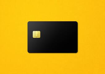 Photo sur Plexiglas Dinosaurs Black credit card on yellow background