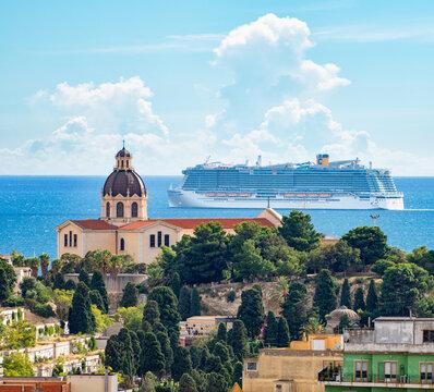 Cagliari, Italy 13/10/2020; Costa Smeralda cruise ship the flagship of the fleet of Costa Crociere, leaving Cagliari city with the church of Bonaria in foreground.