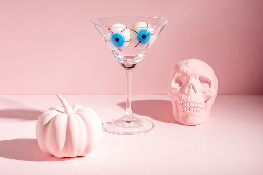 Creative Halloween layout with eyeballs in martini glass. Minimal holiday concept.