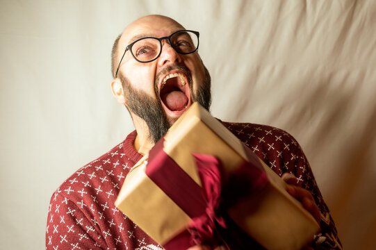 Man is completely freaked out with joy at a gift