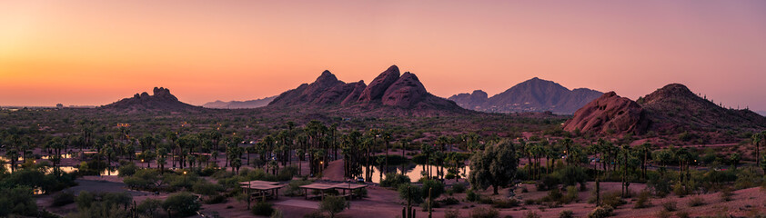 The sunsets over Papago Park in Phoenix, Arizona with Camelback Mountain in the background.