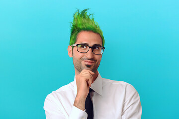 Creative businessman with green hair thinks about a crazy project