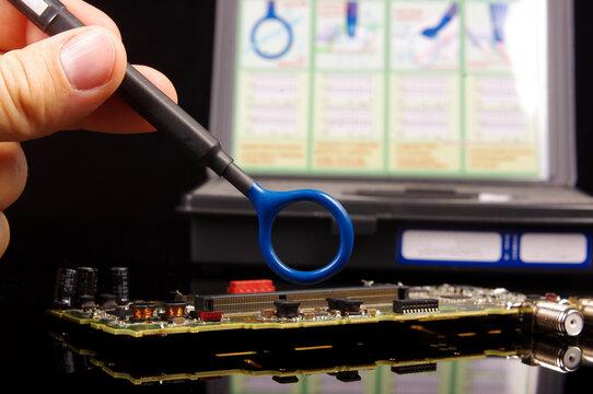 EMC engineer analyzing PCB using near-field probe