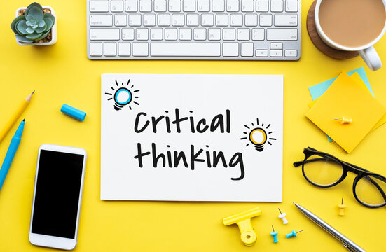 Critical thinking concepts with text on worktable