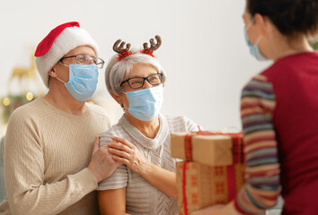 People with gifts wearing facemasks on Christmas.