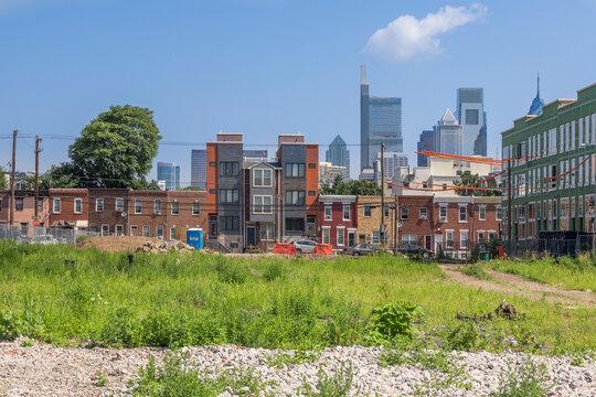 A work in progress - Gentrification in a south Philadelphia neighborhood with downtown skyline.